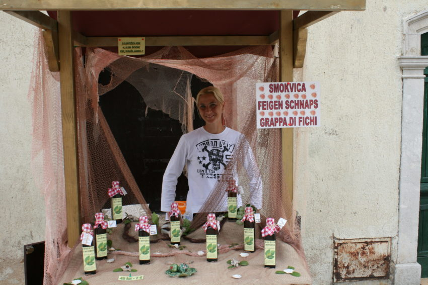 Croatia is one of Eastern Europe's leading producer of Schnapps as this woman on Krk proudly displays