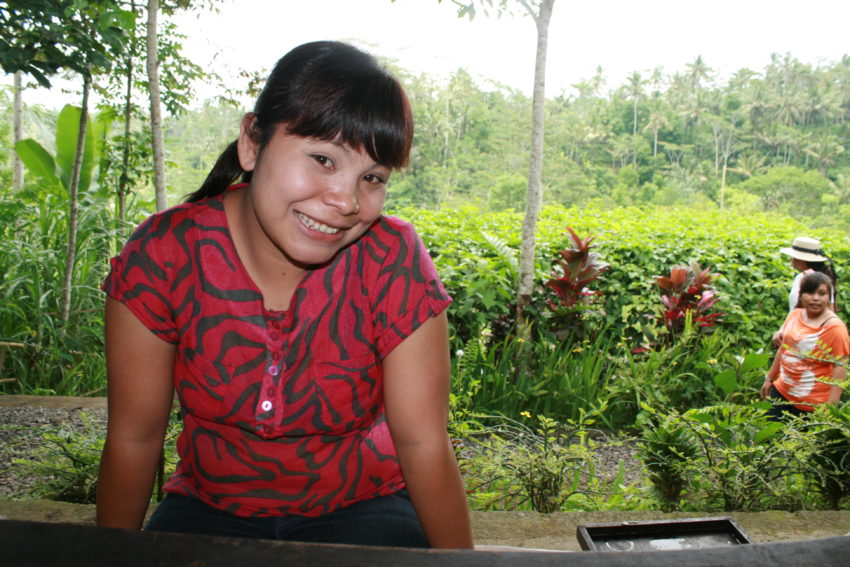 My server at Bali's cool, refreshing coffee plantation