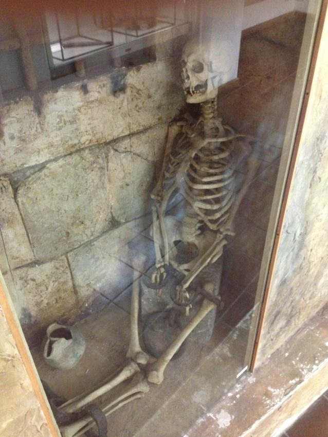 Skeleton of wife of Lord of Poggio Catino who discovered her cheating on him and left her in a cell to starve to death.