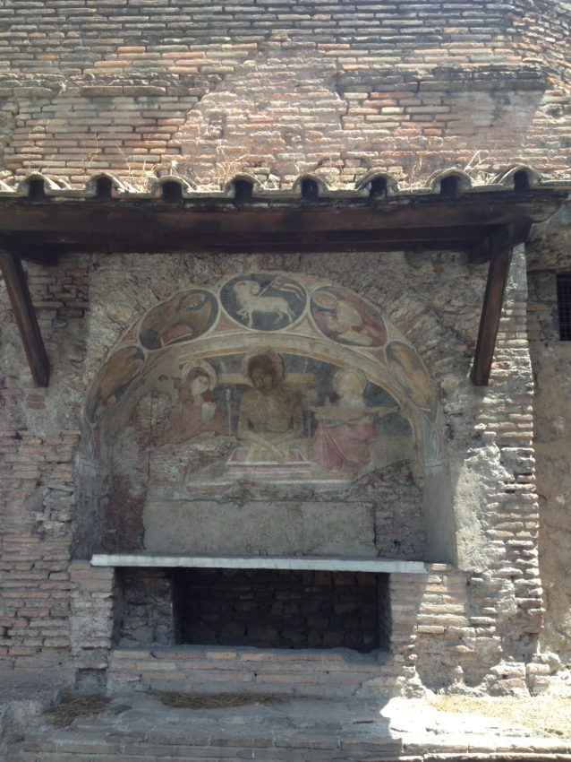 A fresco showing Christ descending from the cross.
