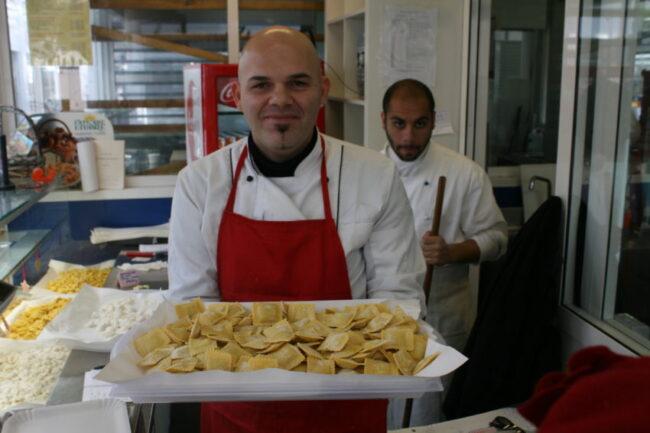 Alessandro holds stuffed ravioli in one of the 100-plus stalls in Rome's Mercato Testaccio.