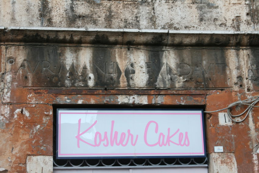 This bakery inside a palace built in 1468, is under a sign still bearing the name of the building owner.