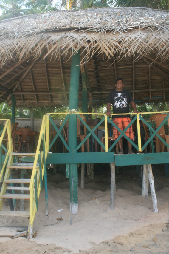 The tsunami's wave came within a meter of the roof of Christian's beach bar here.