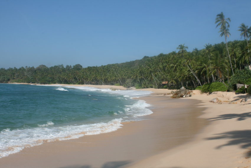 Beautiful beaches and people in Sri Lanka. But first, I must wait for my iPhone.