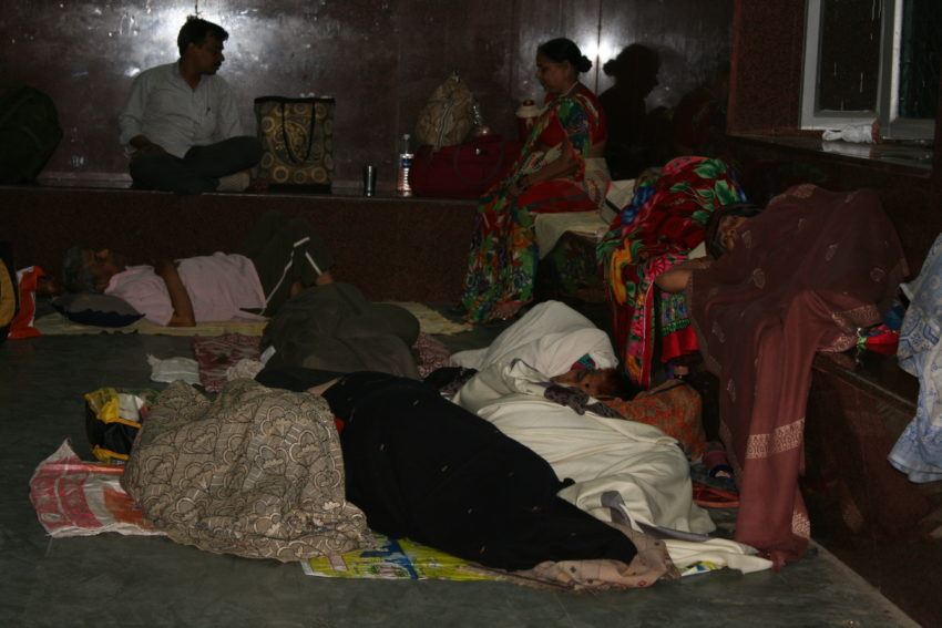 People sleeping in the Agra train station.