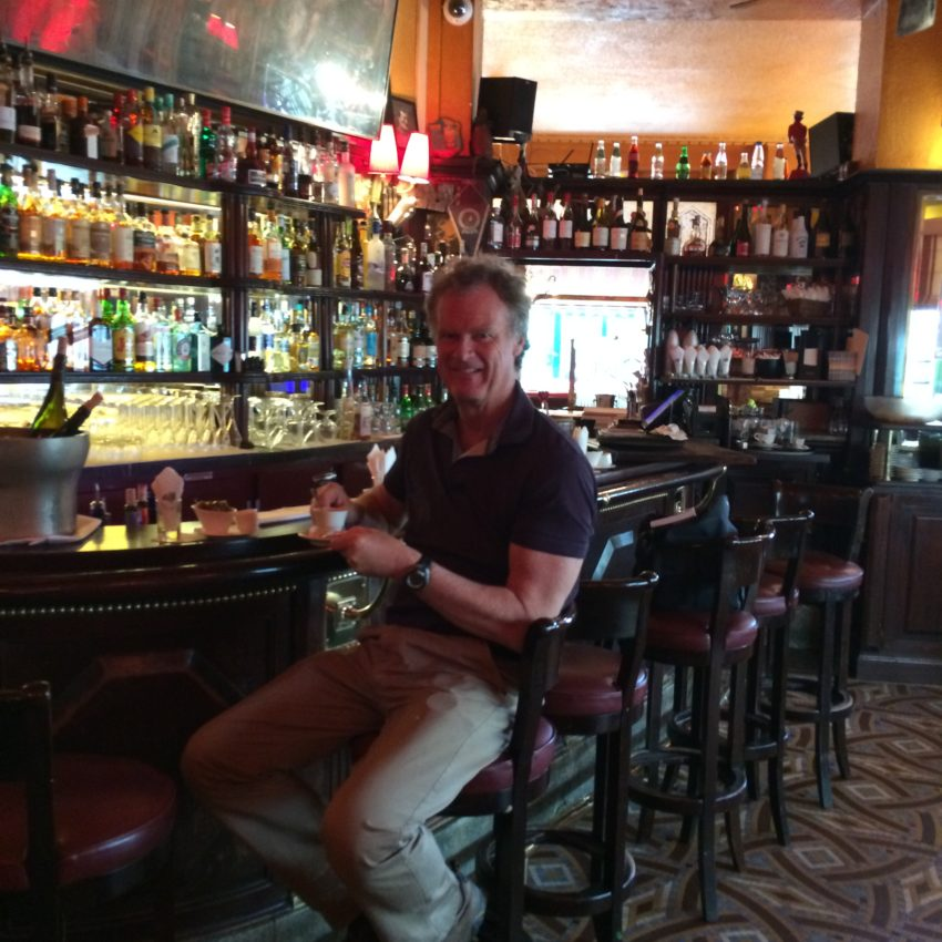 Me in Ernest Hemingway's designated seat at Closerie des Lilas in Paris' Montparnasse district. Hemingway lived in Paris from 1921-28.