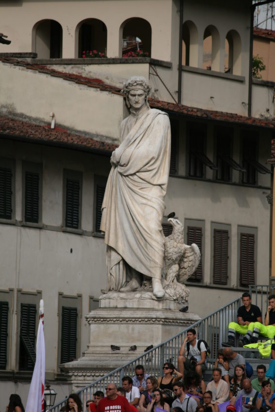 Dante Alighieri looks down from the corner outside the basilica.