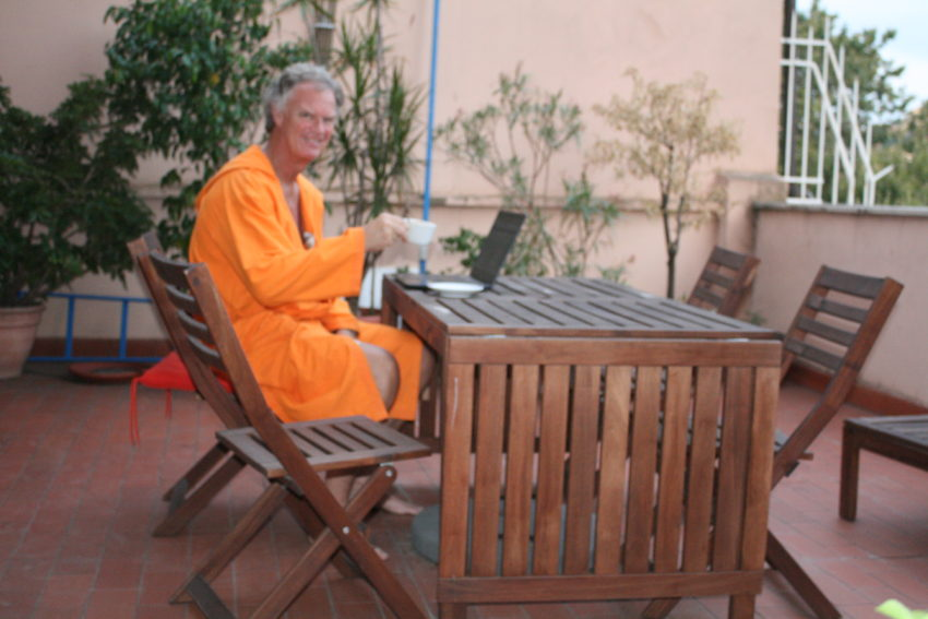 Me on my terrace, my usual perch every morning with my laptop and perfect cappuccino.