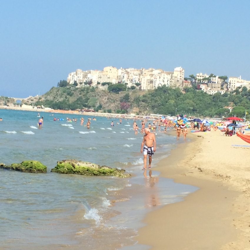 The beach of Sperlonga with the charming old town hovering in the distance.