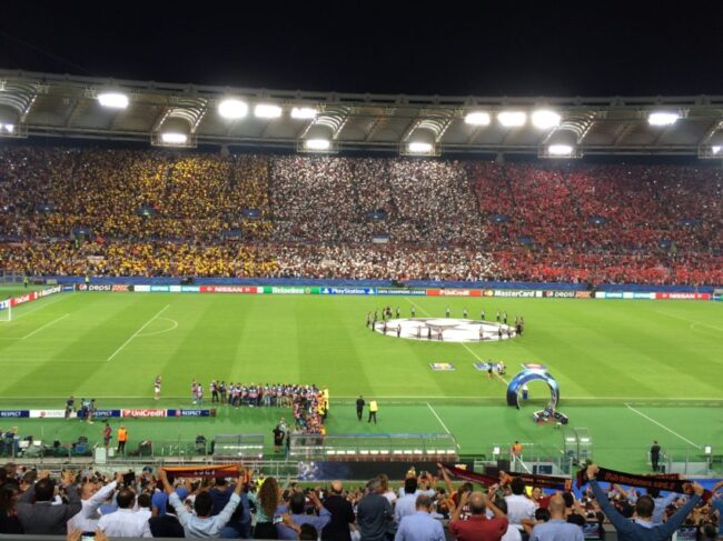 A packed Olympic Stadium crowd of 57,836 watched Roma tie defending champions Barcelona as the Champions League kicked off for Roma Wednesday night.
