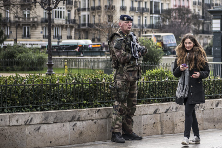 Security in Paris remains tight around the sites of the November terrorist attacks such as this soldier in front of Bataclan theater. Photo by Marina Pascucci