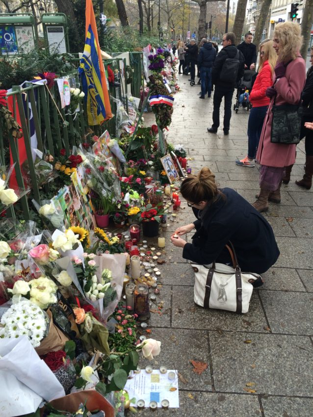 People still pay their respects in front of the Bataclan.