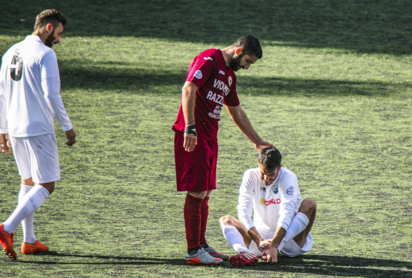 A Trastevere player checks on a Cynthia player faking an injury.