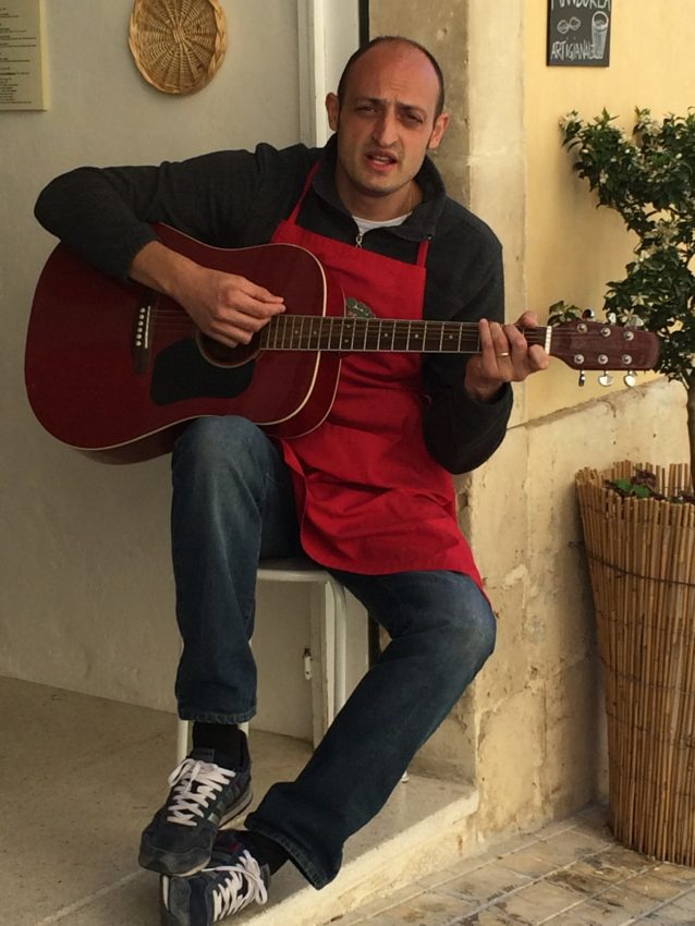 A man sings a Sicilian song outside a granita shop in Noto.