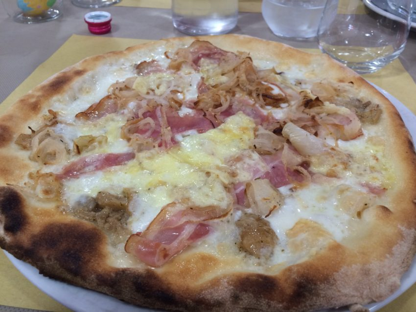 Porchetta (sizzling pig) pizza at Gallo d'Oro in Ragusa.