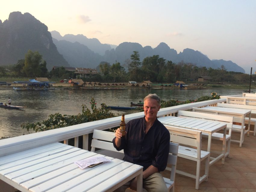 Me at my hotel on the banks of the Nam Song with Laos' towering karsts in the background.
