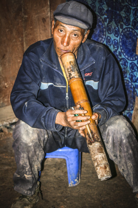Nouje, the village chief of Chakhampa, smoking a bamboo pipe. Yes, it's tobacco.