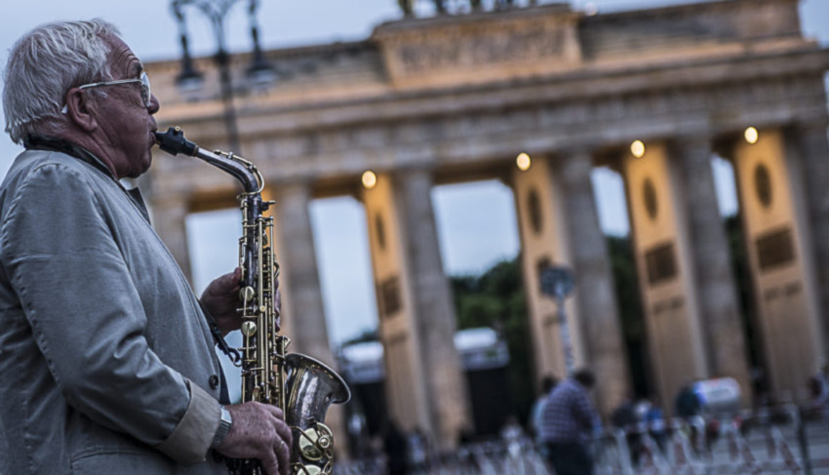 One of the many musicians in front of Brandenburg Gate, once the symbol of East-West division and now one of top attractions to 12 million visitors a year. Photo by Marina Pascucci