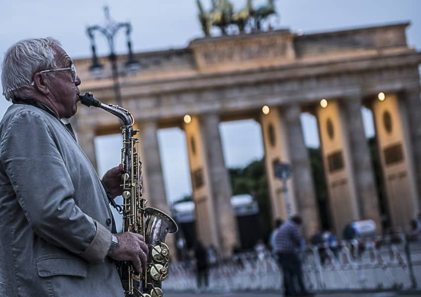 One of the many musicians in front of Brandenburg Gate, once the symbol of East-West division and site of the 1953 East German uprising. It's now one of the top attractions to 12 million visitors a year. Photo by Marina Pascucci