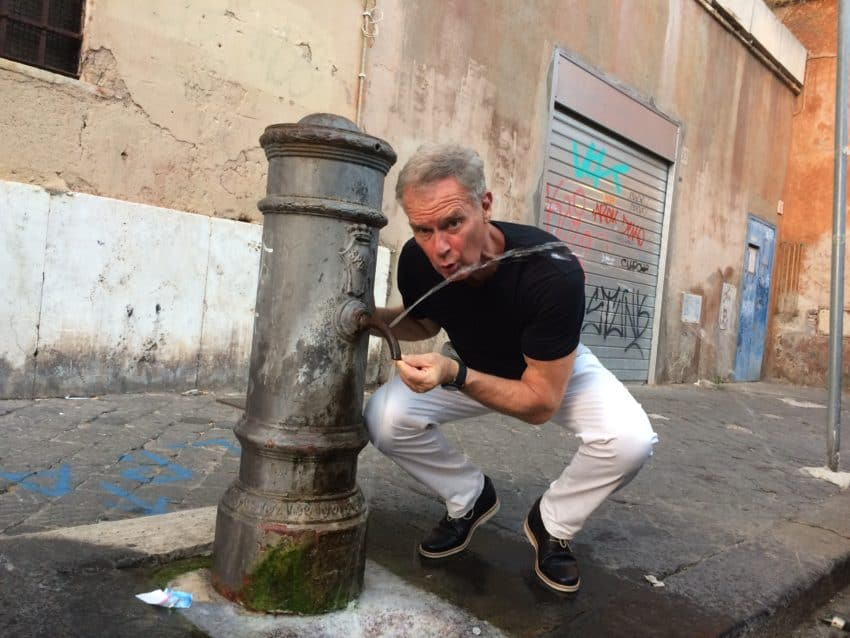 "Me at one of the ""nasoni"" in steaming Rome. The city has 2,500 of them but the water shortage has closed 400. Photo by Marina Pascucci"