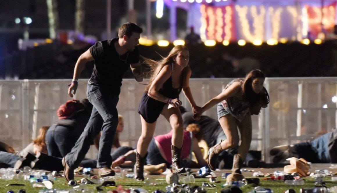 Concert goers run for cover Sunday night in Las Vegas where a gunman killed 59 people and injured more than 500.