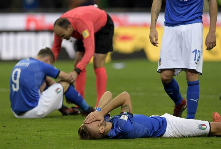 Italy's Ciro Immobile lays stunned after Sweden eliminated Italy Monday. Photo NBC News