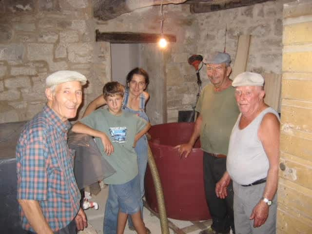 Luigi, left, Hermiti, far right, and Renzo, next to Hermiti, helped son Lorenzo and Claudia build the home. Ev Thomas photo