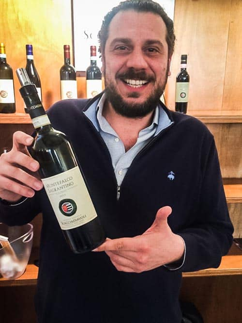 Iacopo Pambuffetti holds up the Sagrantino from his family's Scacciadiavoli winery.