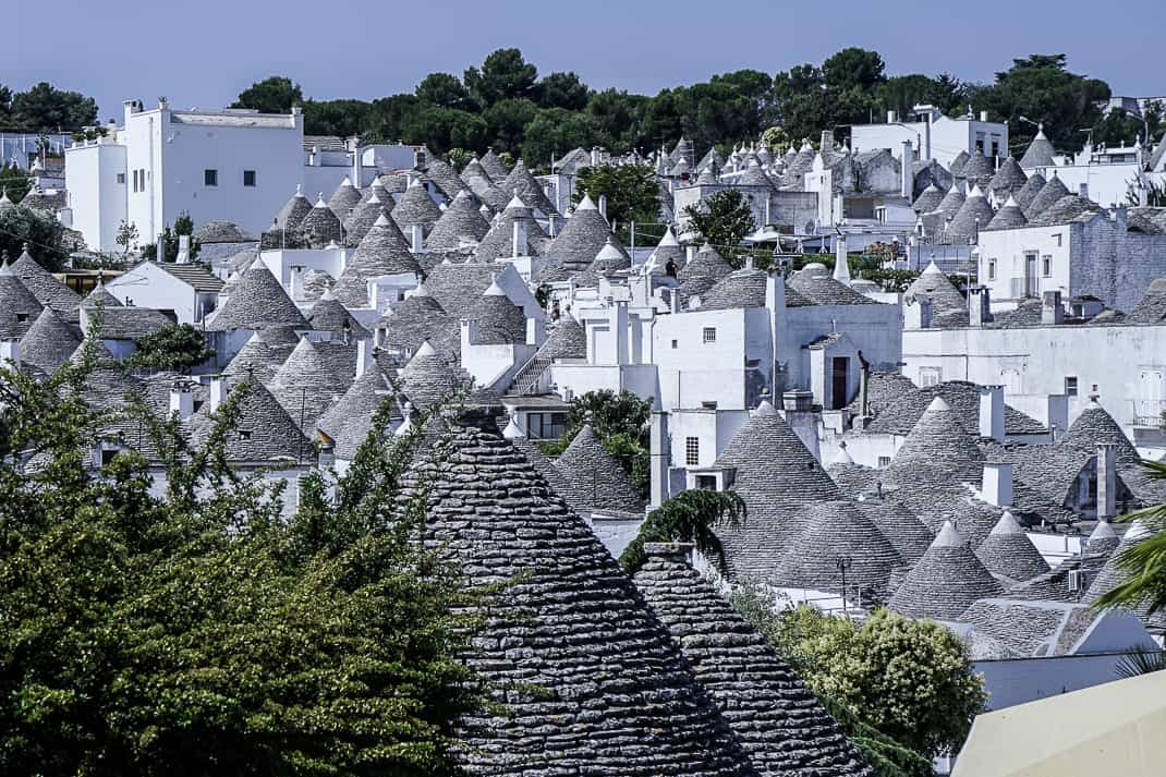 Alberobello is famous for 1,500 trulli, small, pointed-roofed houses used by farmers up to the 14th century