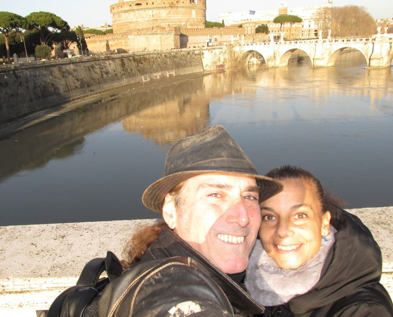 Tom Leitner and his wife, Ilaria, on Rome's Tiber River with Castel Sant'Angelo in the background.