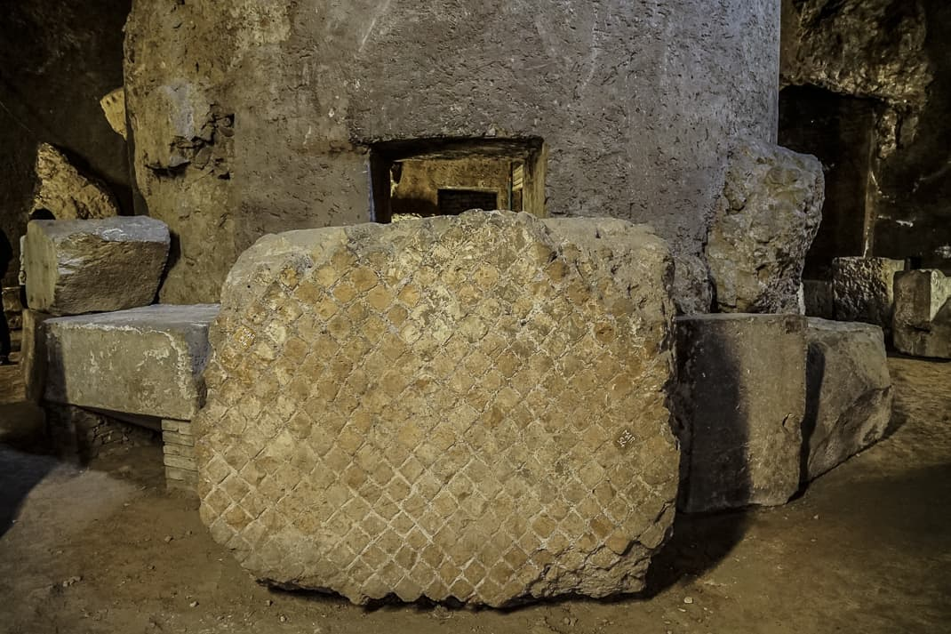 An original stone block and the center that held the urns.