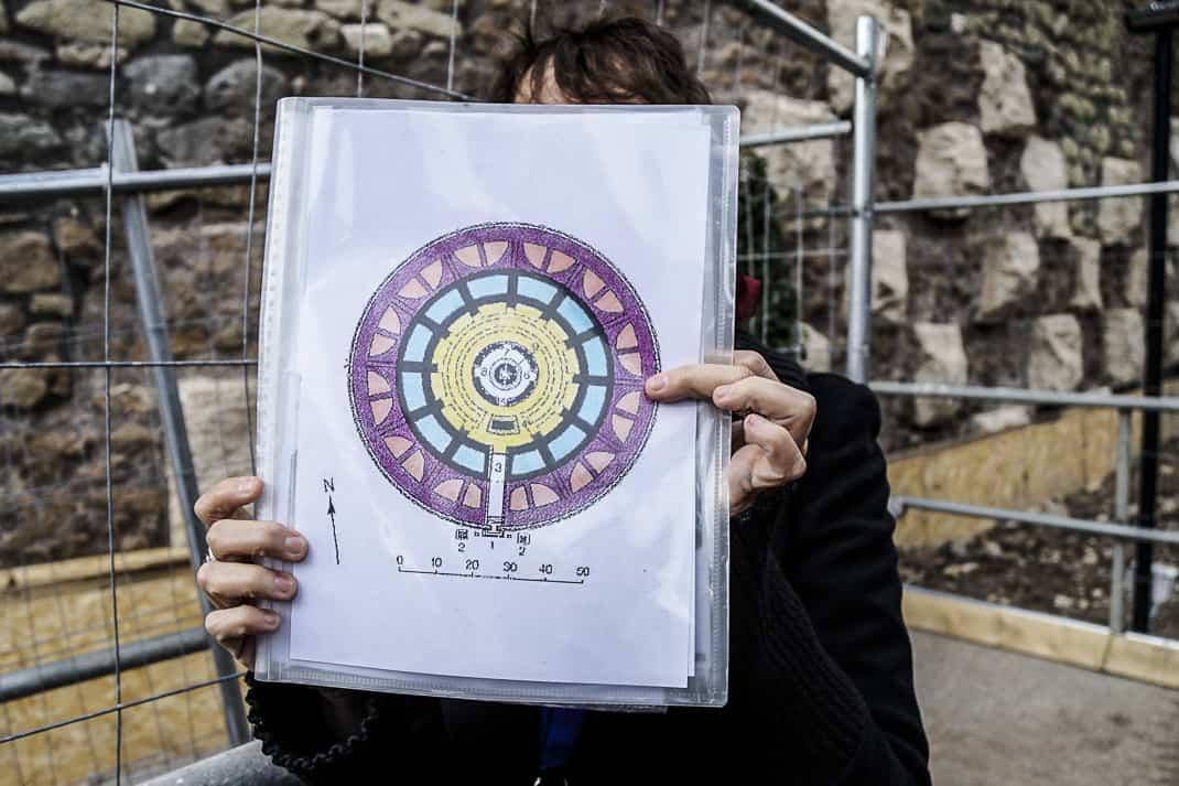 Guide Daniela Tollis holds up a layout of the original mausoleum.