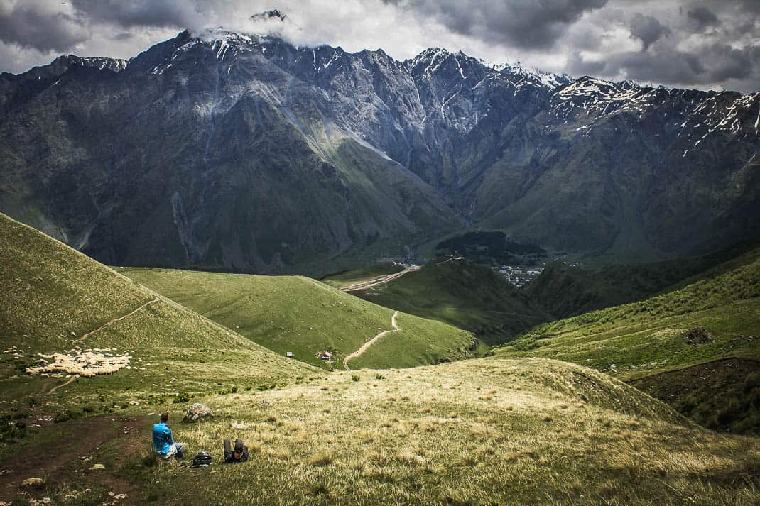 A lone hiker high above Trinity Church in the Republic of Georgia's Caucasus Mountains.