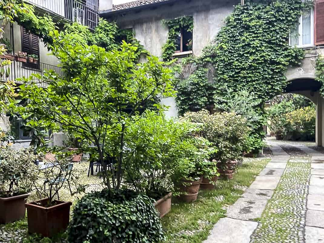 Small, leafy courtyards are hidden in the Navigli's nooks and crannies.