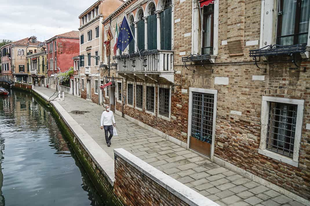 Me walking along one of the many empty streets and canals.