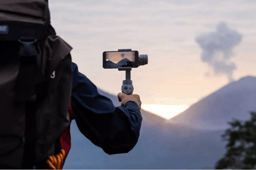 This Osmo Mobile 2 Handheld Smartphone Gimbal rotates in your hand to stop shaking.