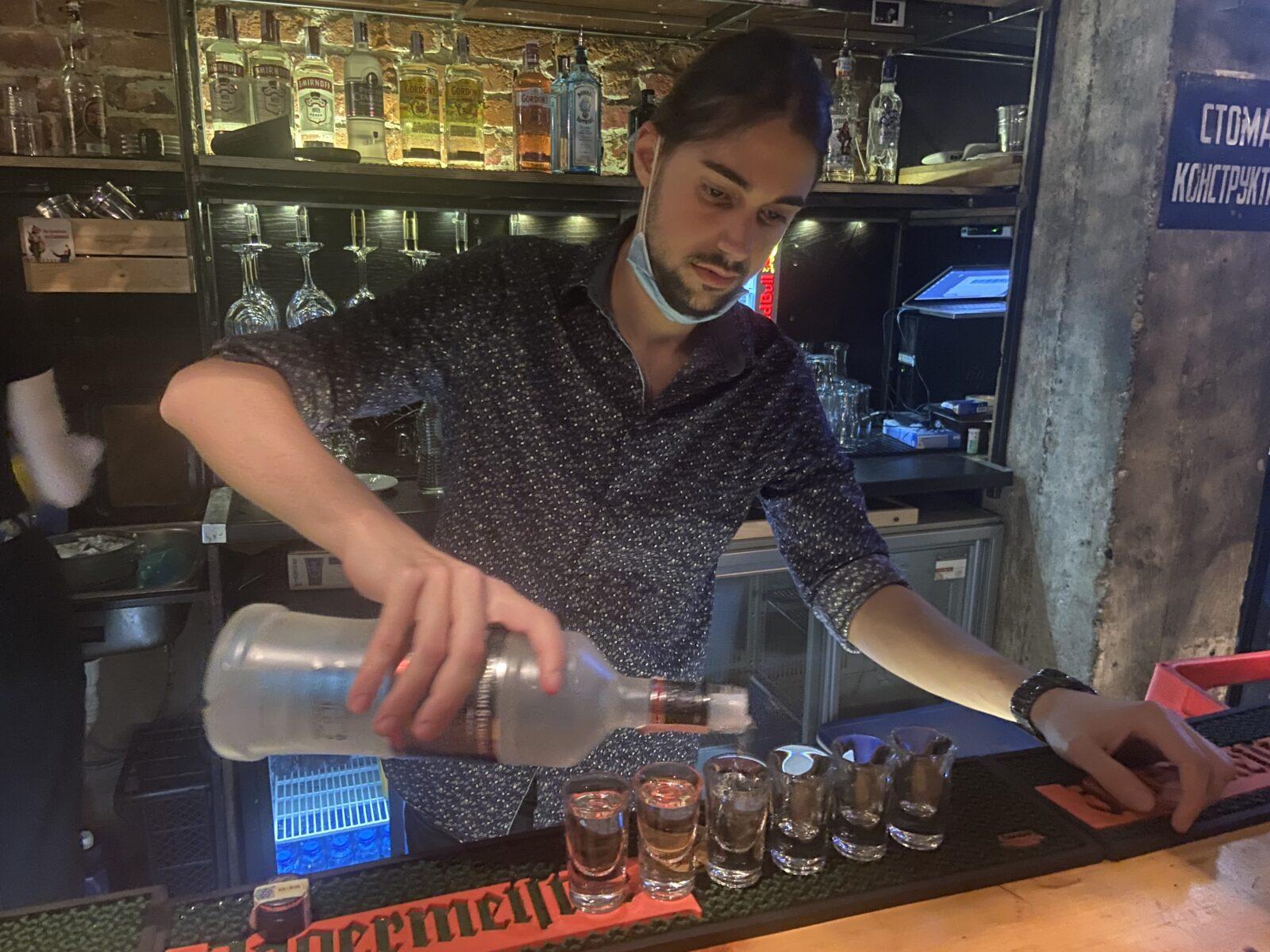 A bartender prepares our shots at Stroeja.