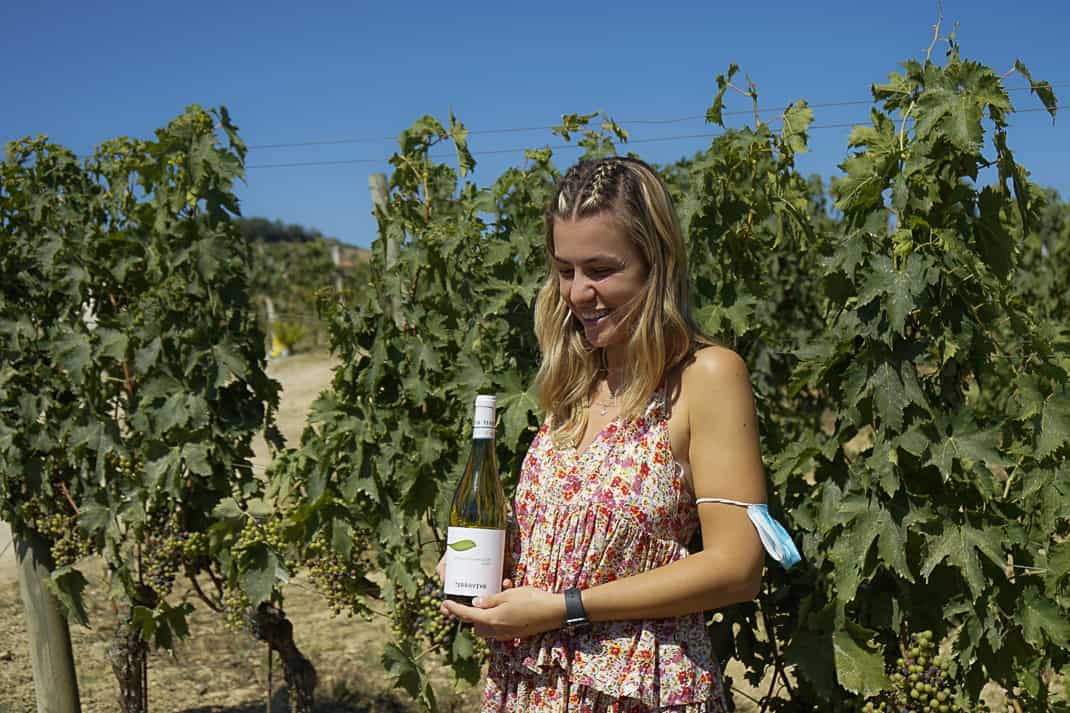 Federica Topi with her bottle of Trebbiano.